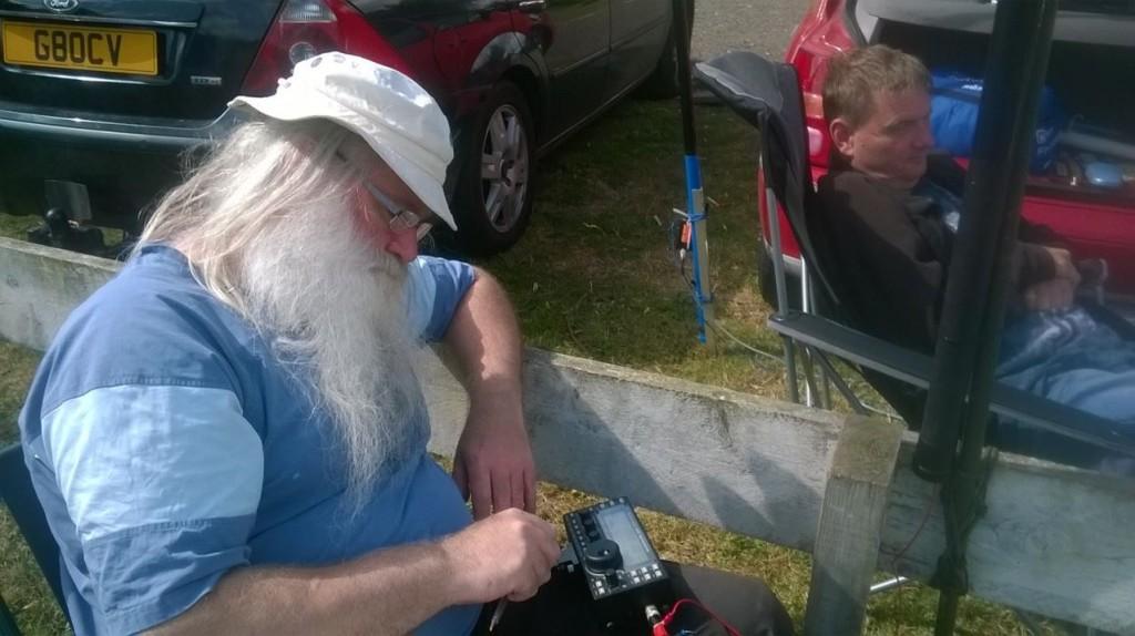 (left) Peter G0DZB) using his Elecraft KA3. (right) Derek M0XTA supervising WSPR but not asleep!